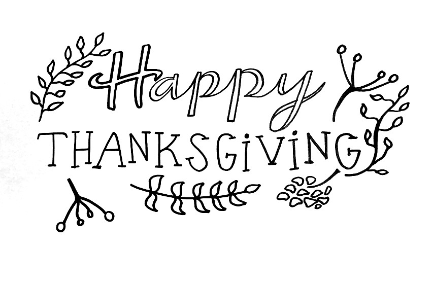 "Leaves surround text that reads ""Happy Thanksgiving"""