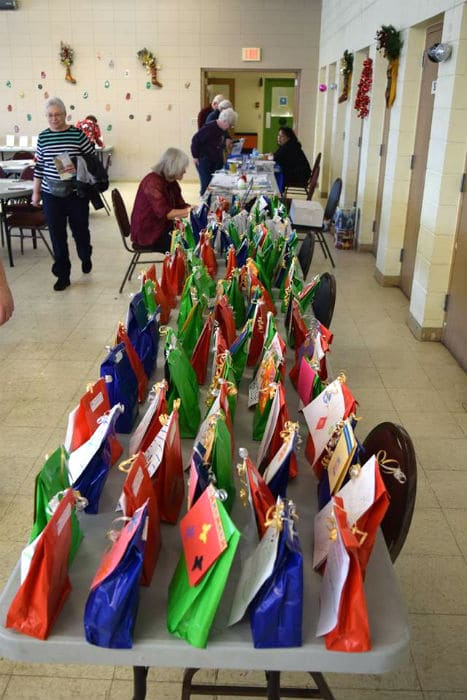 Gift bags lined up on a table