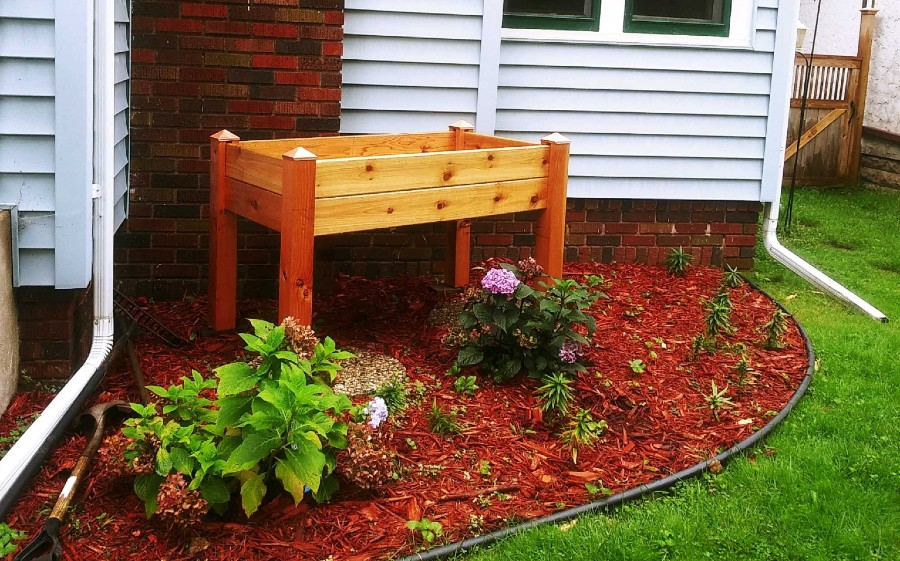 Photograph of a cedar planter in front of a house